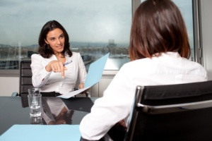 woman interviewing job applicant