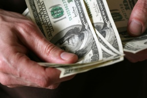money in hand representing costs attorney can recover