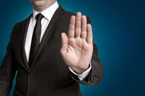 attorney's hand up in stop gesture because there's a conflict of interest between clients