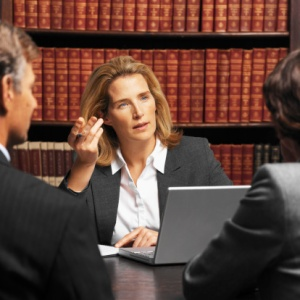 lawyer meeting with clients and getting confidential information